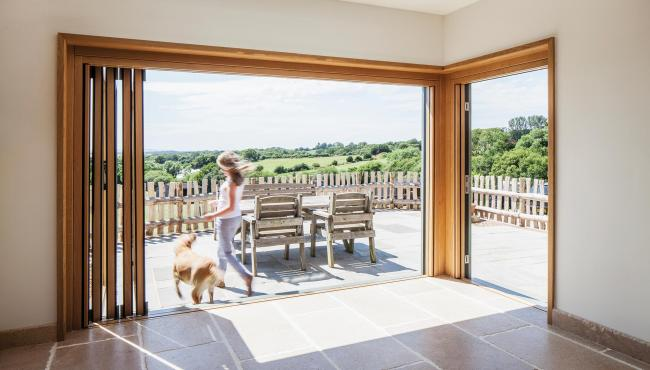 Centor folding doors creating a seamless open living plan for a renovated farmhouse