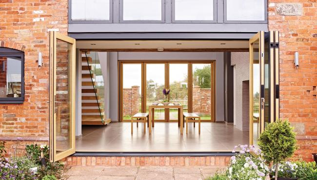 Two Centor Folding Doors with wood interior creating indoor outdoor flow