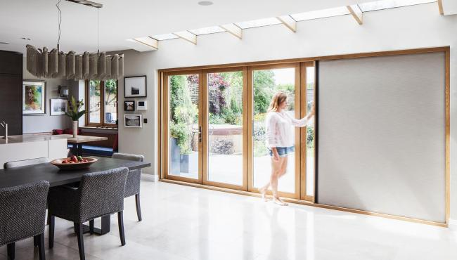 Two joining 205 Integrated Folding Doors with built-in blackout shade