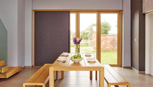 Centor 205 Integrated Folding Door with built-in shade for a barn conversion