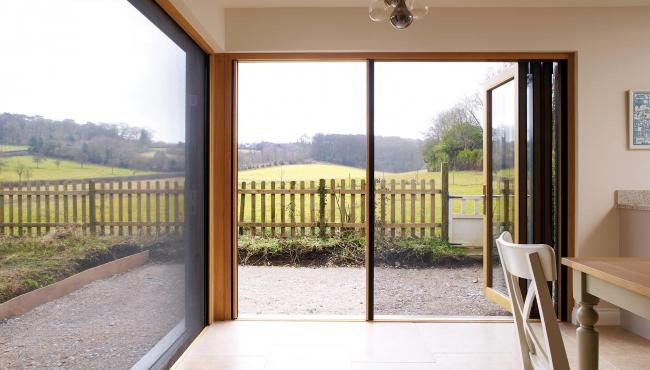 Two joining 205 Integrated Folding Doors with insect screen