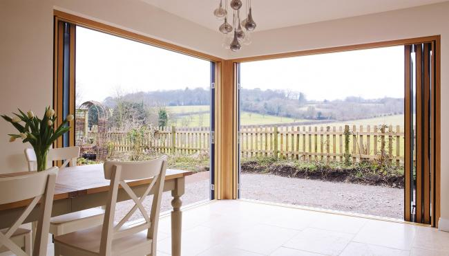Two joining 205 Integrated Folding Doors overlooking farmland