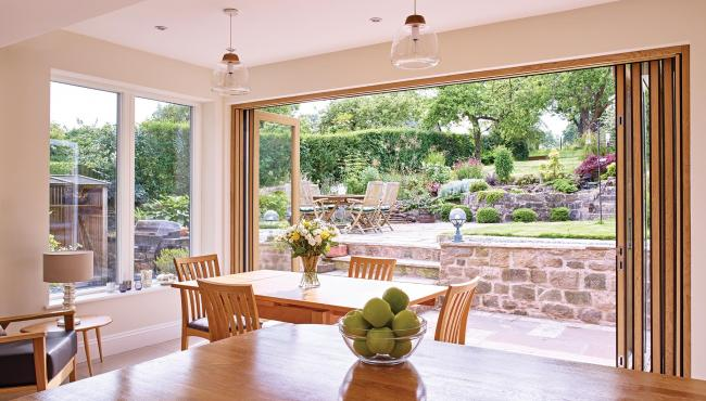 Oak bifold doors from Centor allow to connect with the outside