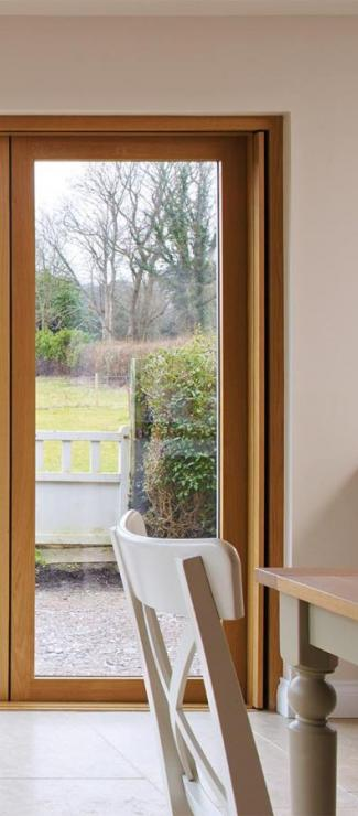 Two joining Centor 205 Integrated Folding Doors in a country cottage