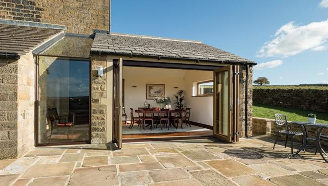 A light filled extension for a stone-built home now maximises spectacular views.