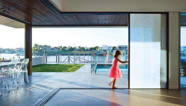207 Cornerless post-free folding door with built in shade for control of sun glare