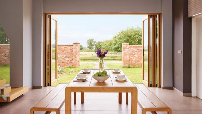 Centor 205 Integrated Folding Door with doors open to farm land