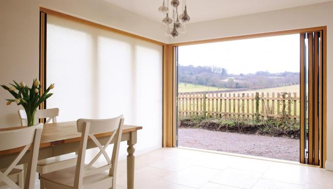 Two joining 205 Integrated Folding Doors with built-in light-filtering shade