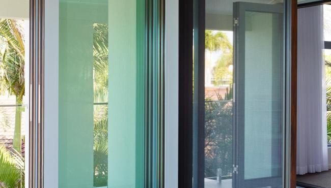 Centor folding patio door with custom retractable fly screen