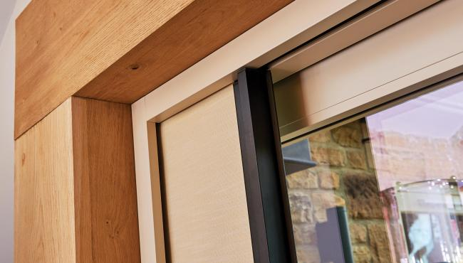 Centor blinds for bifolds are built into the door frame to help save space