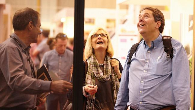 Homeowners amazed with Integrated Doors with integral fly screen at Grand Designs Live