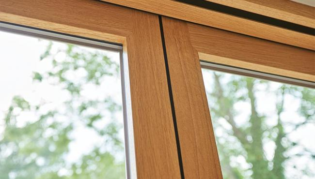 Folding door hinge is hidden from sight within the edge of the door