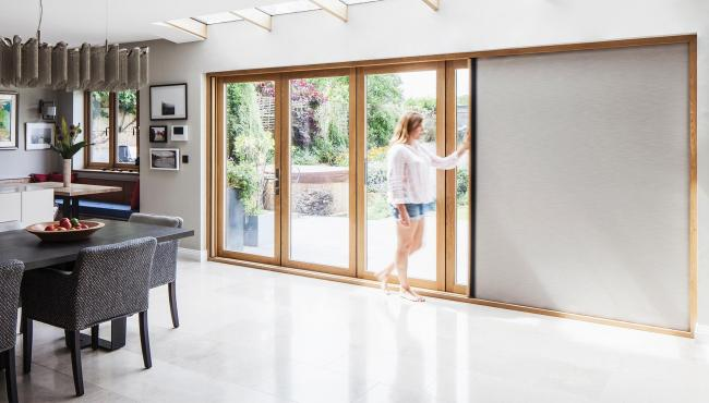 Centor 205 bifold patio door with retractable blind built into the door frame
