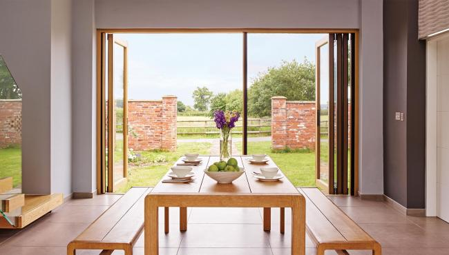 Centor 205 Integrated Folding Door with built-in insect screen for a barn conversion