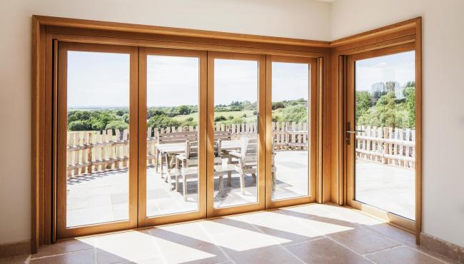 205 Integrated Folding Door transforming a country style living space