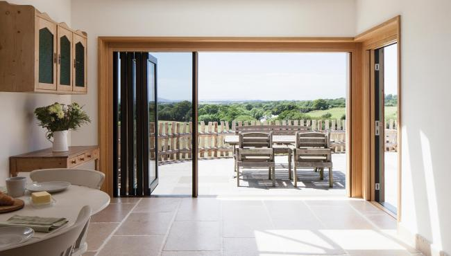 205 Integrated Bifold Door with built-in insect screen to keep insects and pests out of their kitchen and dining room