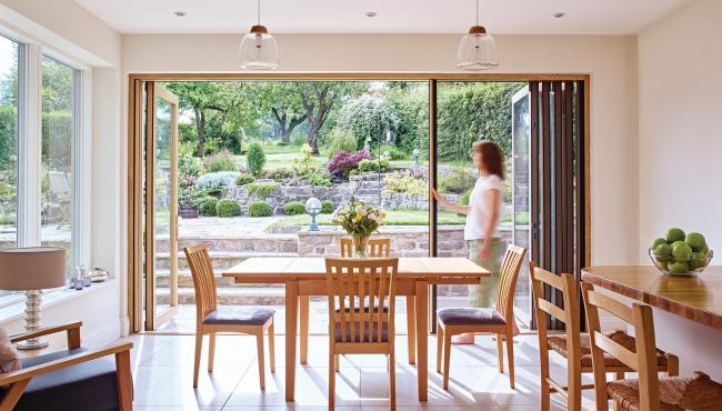 Centor folding patio doors with retractable fly screen to keep insects out
