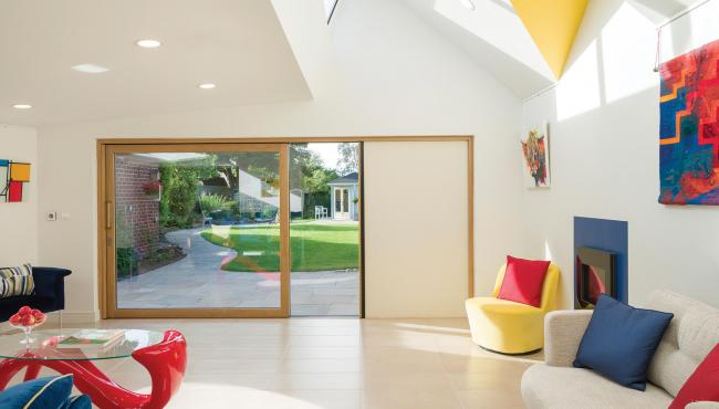 Contemporary sliding door from Centor has an integral blind for added privacy and control of glare