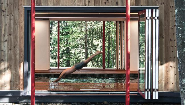 Integrated bifold doors allow this structure to be functional during any season