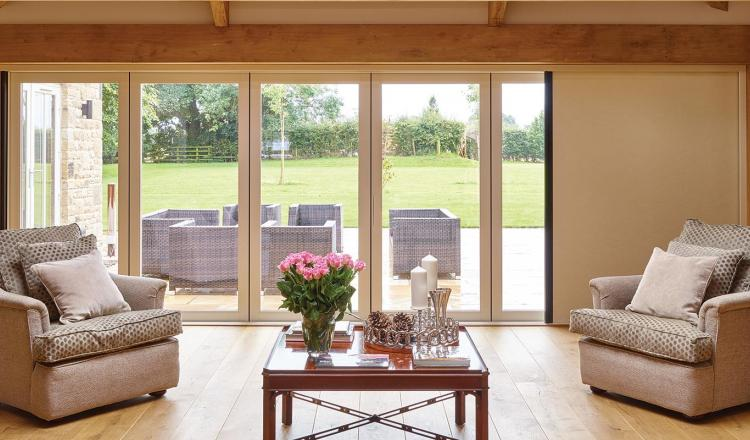 Centor aluminum bifold door featuring a built-in insect screen and shade