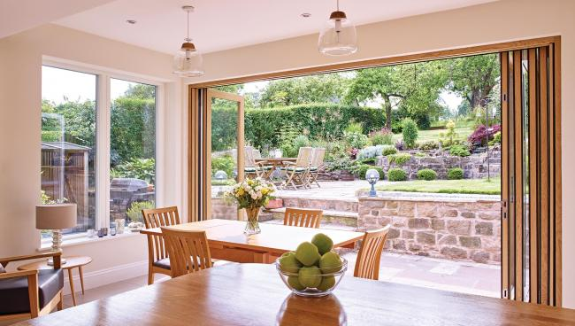 A couple's existing extension is completely transformed to invite in picturesque views of their garden.