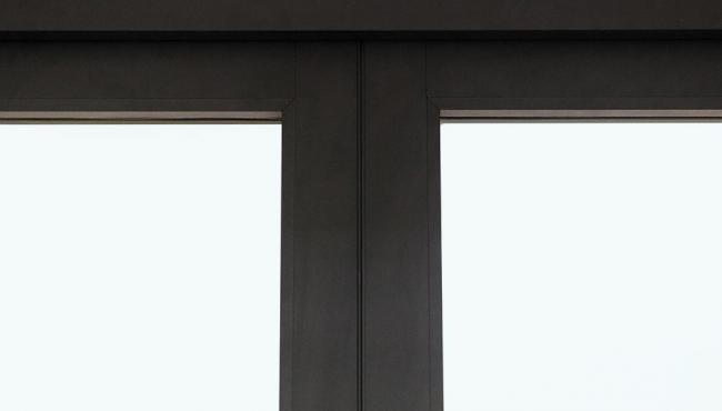 The concealed hinge on folding doors is hidden from sight within the edge of the door